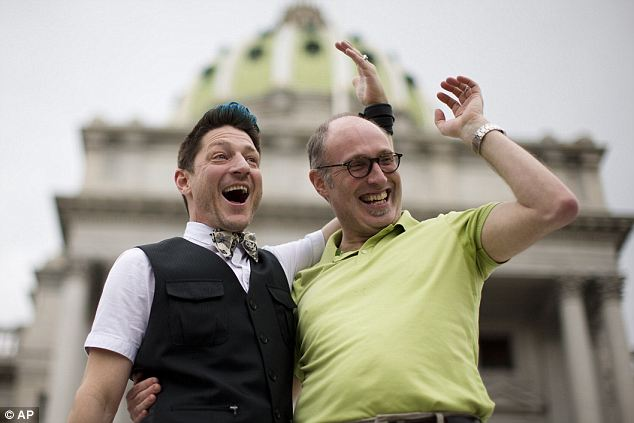 Doing it the legal way: Just engaged Jefferson Rougeau, left, and Steven Creps pose for photographs on the steps of the state Capitol Tuesday in Harrisburg, Pennsylvania