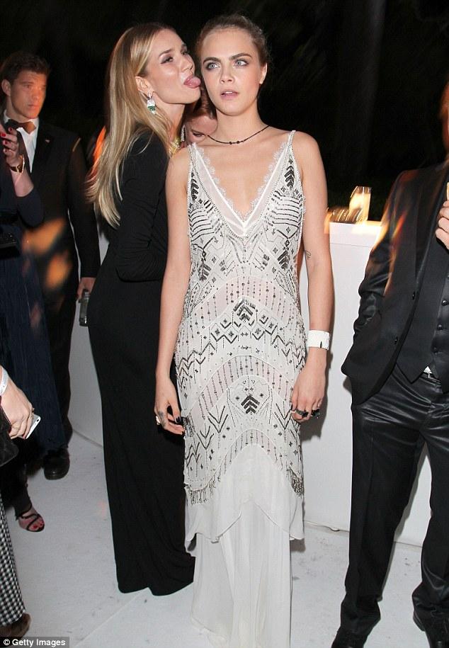 Photobomb: Rosie got cheeky behind Cara in one snap