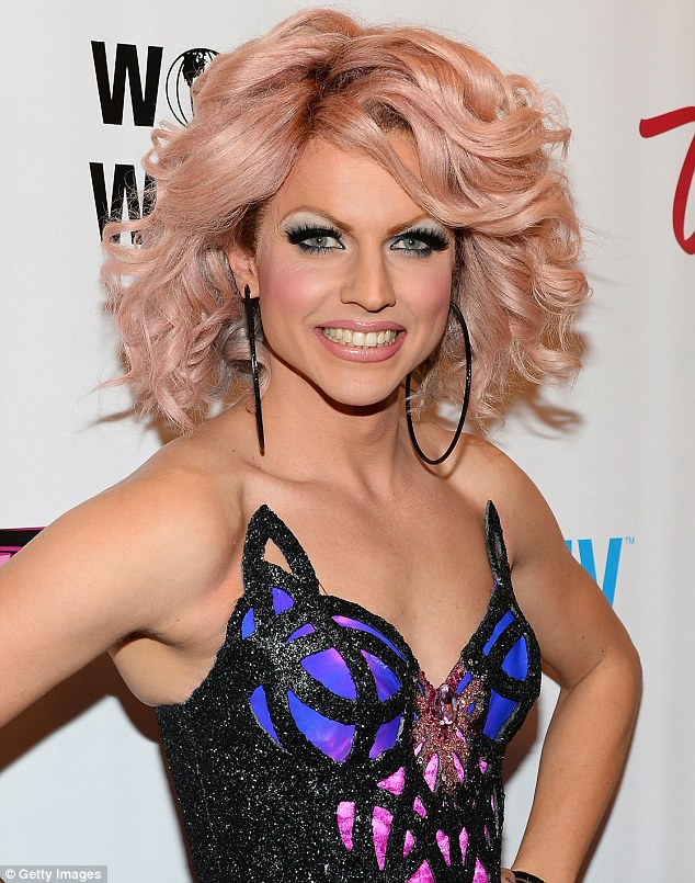 Statement look: The Australian drag queen sported bold black eye makeup and voluminous blonde curls for the event