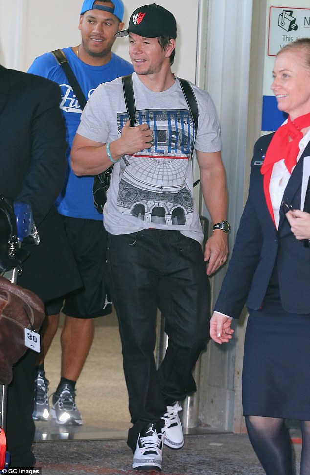 Look at those guns! A muscular Mark Wahlberg showcased his bulging biceps as he touched down in Melbourne on Wednesday ahead of the Transformer's Age Of Extinction sneek peek event in Sydney - he missed his flight in Los Angeles and had to take a detour