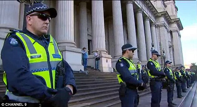 Picket line: Hundreds of police officers watched over the protesters around Melbourne parliament house