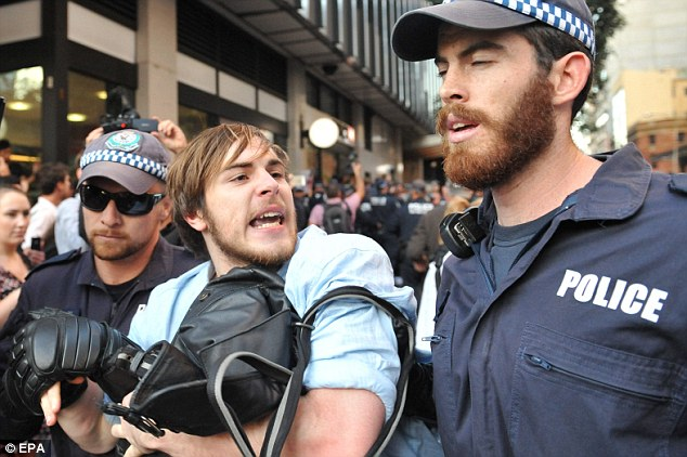 This protester was arrested by riot squad police as he marched through Sydney streets protesting budget cuts to higher education