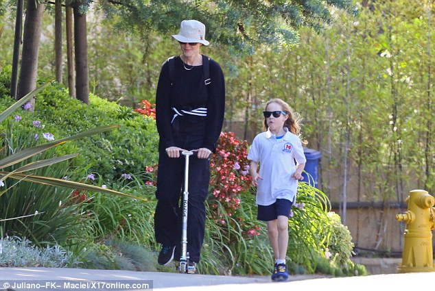 Leafy walk: The ex-Desperate Housewives star is enjoying a break from acting to spend time with her family