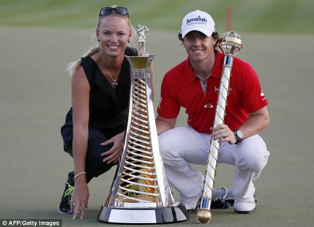 Proud moment: Wozniacki celebrated with the golfer when he won the DP World Tour golf Championship in Dubai on November 25, 2012