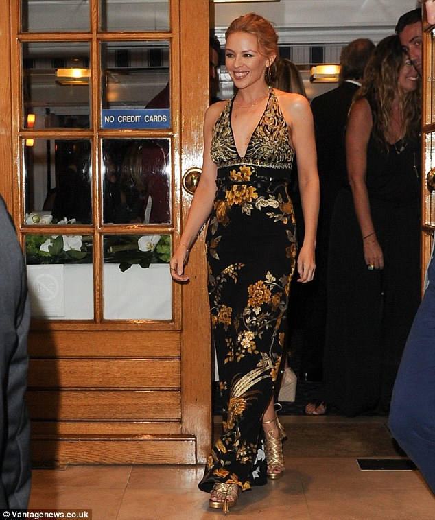 Stepping out: The slight split at the bottom of the Kiss Me Once hitmaker's outfit exposed her gold high heeled shoes