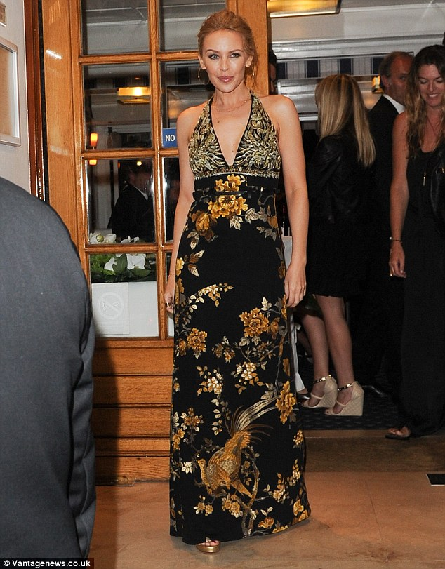 Flower power: Kylie Minogue stepped out at the star-studded Vanity Fair party in Cannes looking delightful in a floral maxi dress