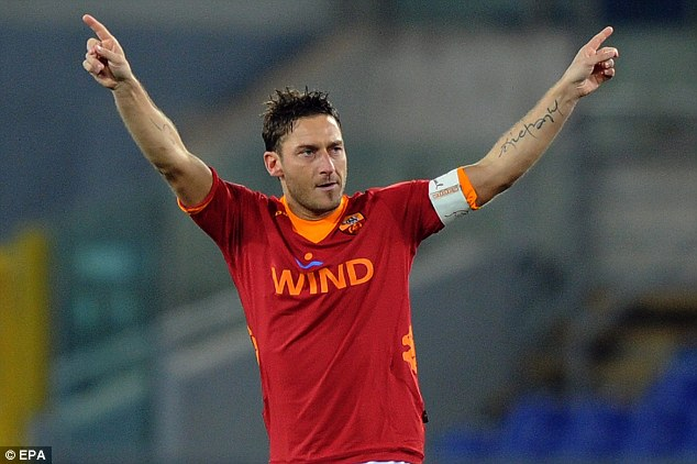 Falling out: Enrique denied a rift between himself and Roma talisman Francesco Totti when he was boss