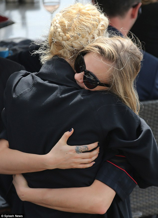 Hug it out: Cara didn't seem to want to let go as they said their goodbyes