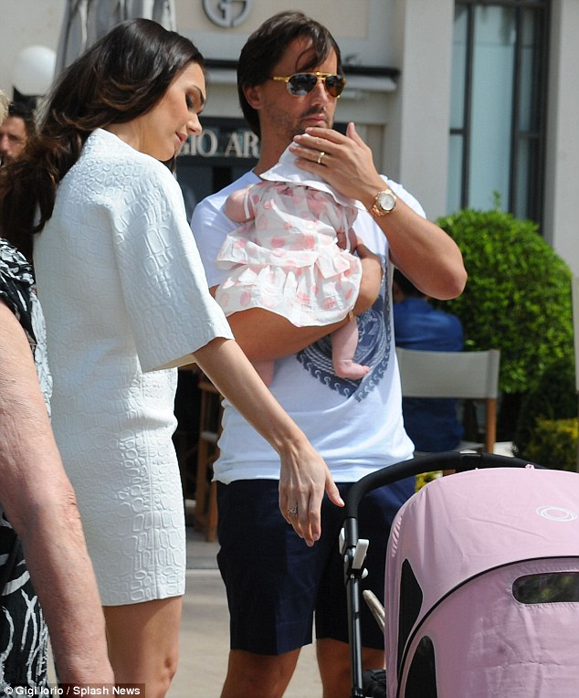 Loving: The family take a break close to a nearby Giorgio Armani store