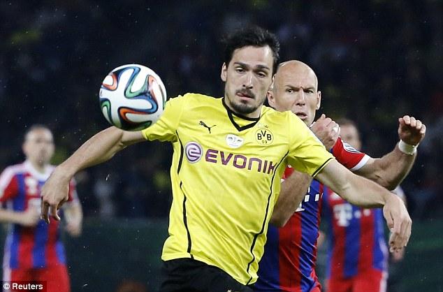On the list: Borussia Dortmund defender Mats Hummels (front) is one of Van Gaal's targets