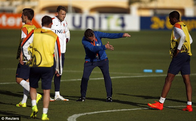 Over here: Van Gaal (centre) is animated as he gives his team orders during the training session in Lagos