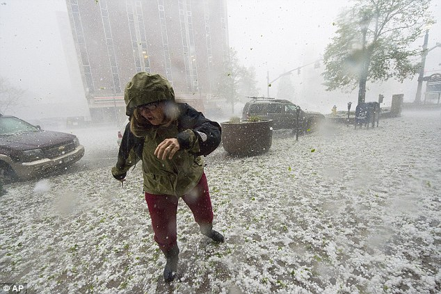 Supercell: A pedestrian runs for safety as a hail storm hits downtown Colorado Springs, Colorado on Wednesday