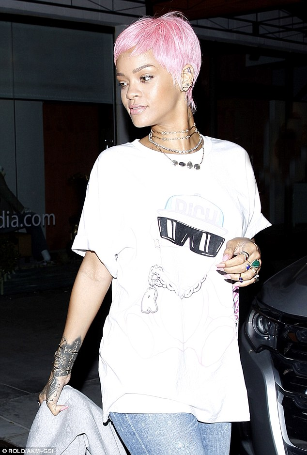 Summertime style: The singer, seen leaving Mastro's Steakhouse in Beverly Hills May 19, tweeted, 'We raided Nicki [Minaj]s wig closet for the summer! Bad gals just wanna have fun!'