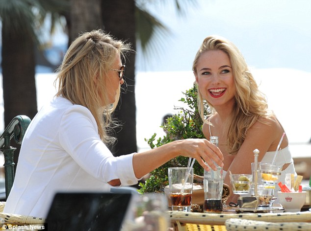 Good times: Kimberley and her sister catch up over drinks in cannes