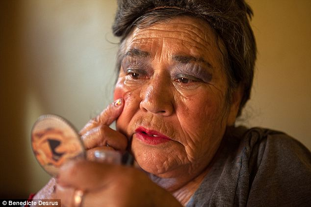 Can't put it down: Amalia, a resident of Casa Xochiquetzal, puts on makeup before going out to work on the streets of the La Merced neighborhood of Mexico City in 2010. The residence mostly houses retired sex workers, though not all of them stay that way or even intend to give it up once they move in