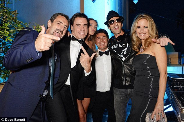 Let's do this: (L-R) Domenico Giannini, John Travolta, Lara Lieto, Oscar Generale, Adrien Brody and Kelly Preston let their hair down on Wednesday evening