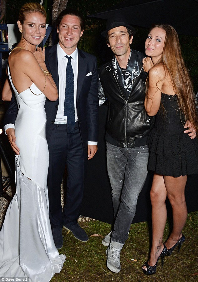 Good times: Adrien and Lara hang out with supermodel Heidi Klum and Vito Schnabel at the welcome party for Puerto Azul Experience Night at Villa St. George in Cannes on Wednesday evening