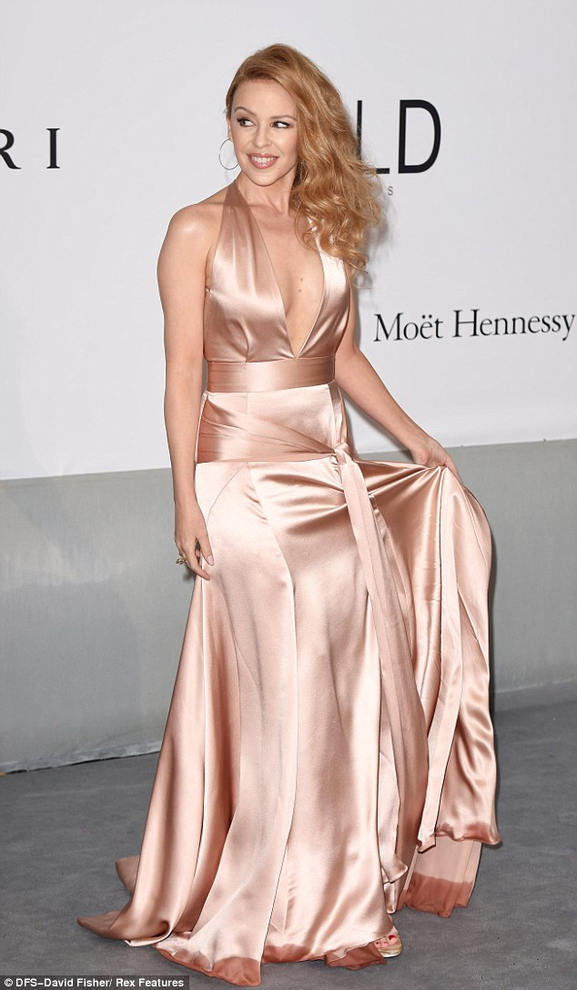 Raining on: Kylie's dress showed a little moisture at the bottom from a sudden downpour in Cannes