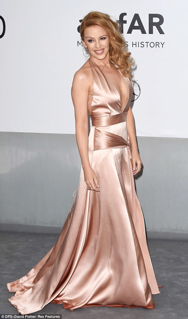 Sweeping glamour: Kylie's satin dress was a dream of satin fabric