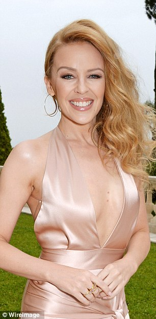 Smiley Minogue: Kylie looked simply stunning in her plunging gown