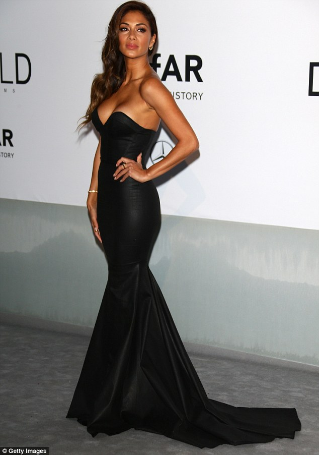No room to breathe! Nicole's dress was eye- wateringly tight and very low cut