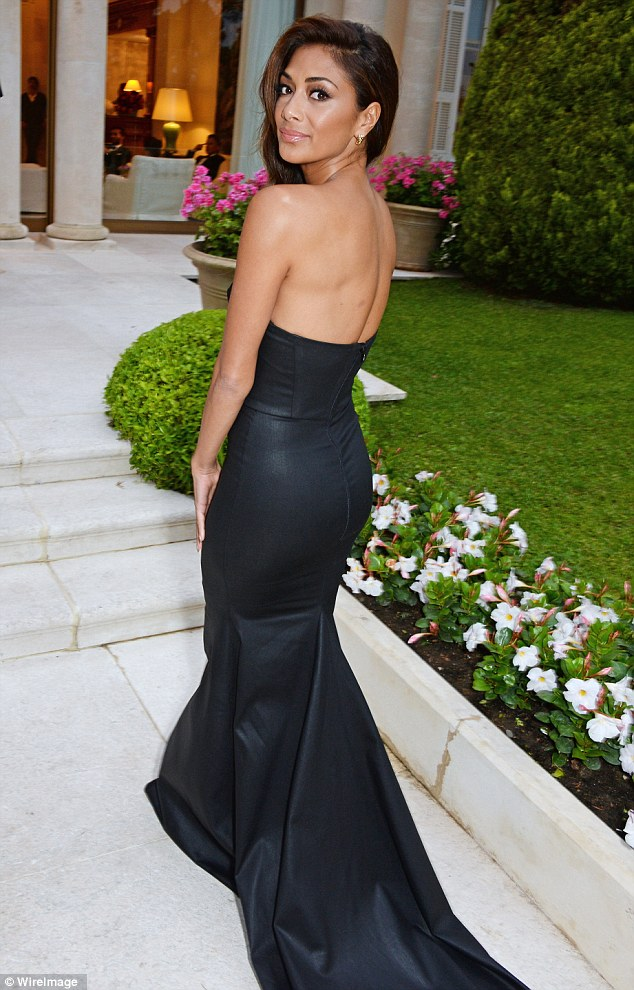 Quite the tail: Nicole's dress featured a fishtail hem and a long train