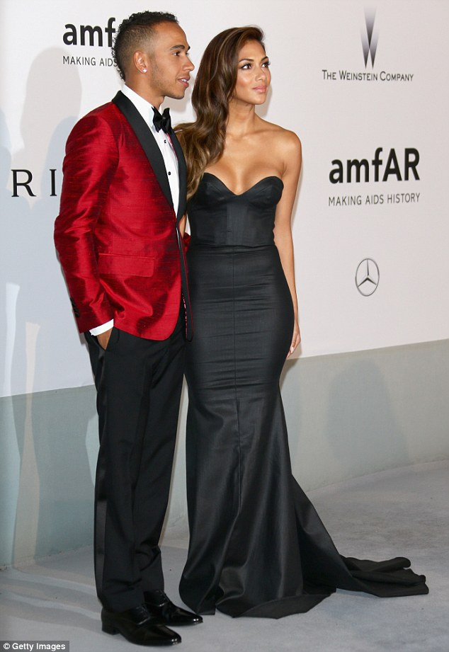 Run for her money: Lewis wore a red tuxedo jacket so he wasn't completely upstaged by his girlfriend