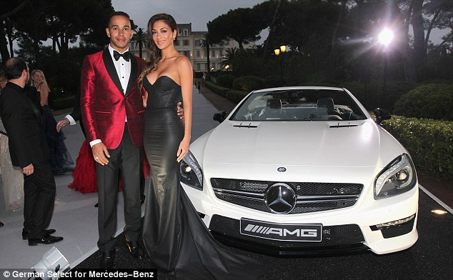 Well, he is a car man: The couple were more than happy to pose up with one of the Mercedes