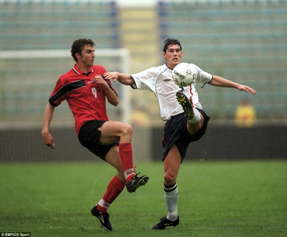England's Gareth Barry clears from Albania's Dritan Babamusta during a European U21 Championship qualifier in 2001