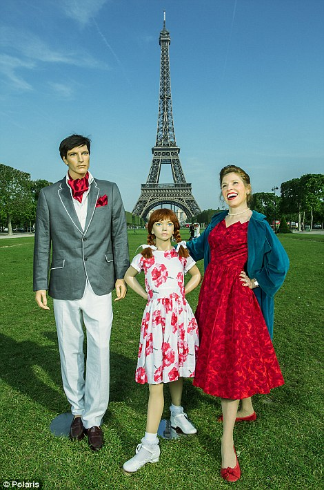 In front of the Eiffel Tower, one of the world's most iconic tourist destinations with her imitation family