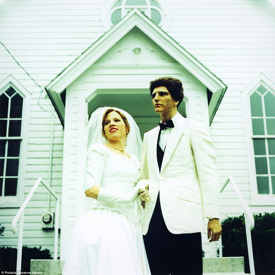 Suzanne poses with her imitation husband for a mock wedding portrait outside of a local Chapel