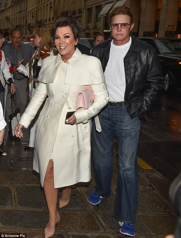 Momager's here! Kris looked tres chic in a white coat on Wednesday... while estranged husband Bruce kept things a lot more casual