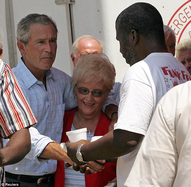 Too little too late: President Bush, seen here visiting a food bank during the disaster, was criticised for the slow federal response to Hurricane Katrina
