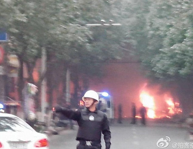 A blast has rocked the capital of China's western region of Xinjiang, after explosives were hurled from two vehicles, killing and injuring at least 31 people