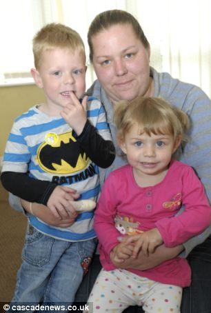 Mother Natalie Cope (right), 25, has hailed her four-year-old son Jamie (left) a hero after he found sister Amelia, 2, (front) floating in a 5ft deep pond