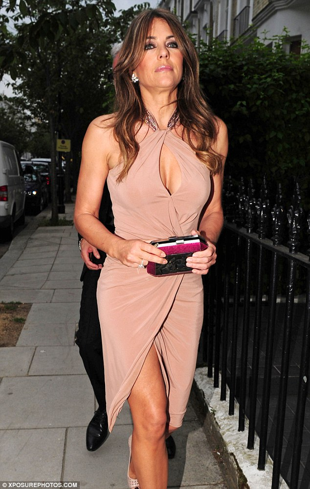 Elegant: But Holly was not the only glamorous star at the event as Elizabeth Hurley also looked stunning as she attended the bash