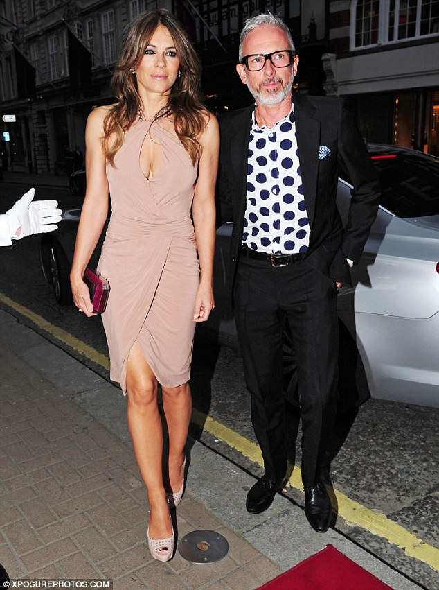 Slim pins: Elizabeth looked sublime as she attended the event with a male friend