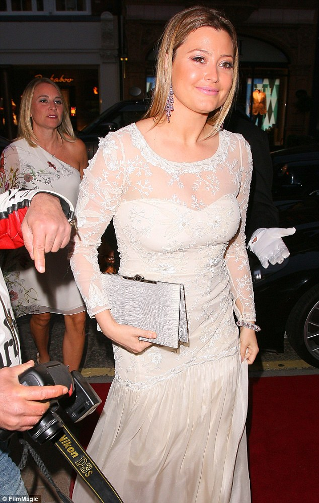 You're married! Holly Candy appeared to be re-living her nuptials to some extent on Wednesday night as she headed to a charity event in London wearing what looked remarkably like a wedding dress