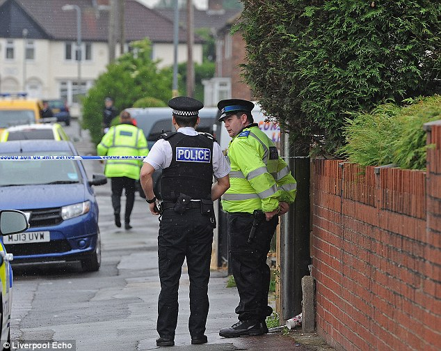 Sealed off: Police have cordoned off the cul-de-sac amid claims the gun fight may have been linked to a hostage situation