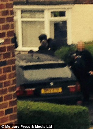 Neighbours described the drama as they watched armed officers flood their street.