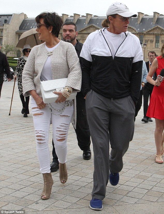 Dressed down: The pair both went for casual ensembles for their day out at The Louvre museum in the City of Lights, with Kris, 58, opting for a pair of ripped white jeans