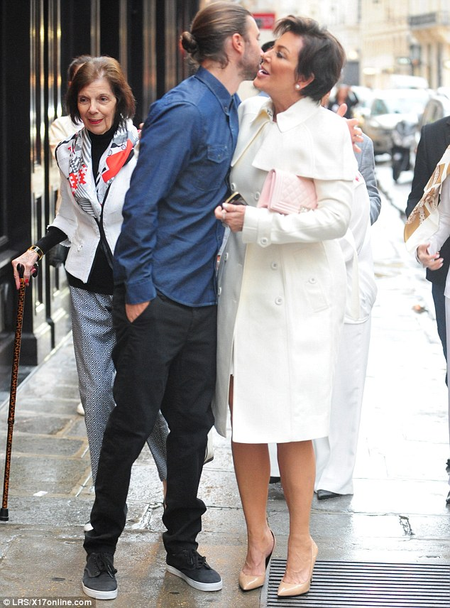 Family outing: Kris was greeted by step-son Brandon Jenner outside the establishment, which she visited with her mother Mary Jo Campbell (left)