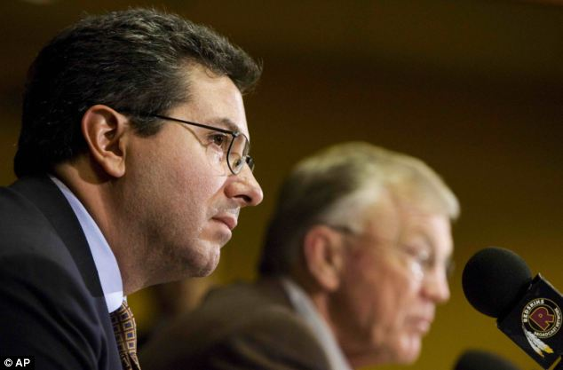 Washington Redskins owner Dan Snyder (L) has steadfastly refused to change the team's name, citing its long tradition and fans' enthusiasm to keep it