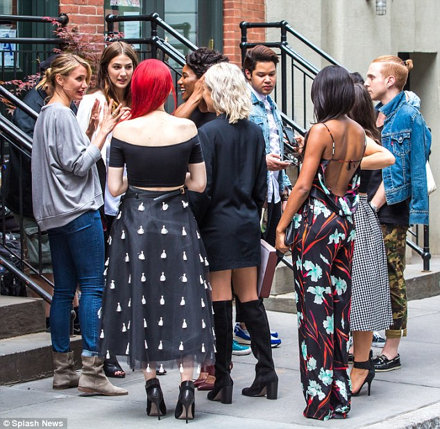 'Our brand doesn't presume to tell you who or what you should be; it is meant to help you be who you are': The star expertly wrangled her half a dozen or so models as well as her crew as she got everything set-up for the day's shooting in the DUMBO area of the city