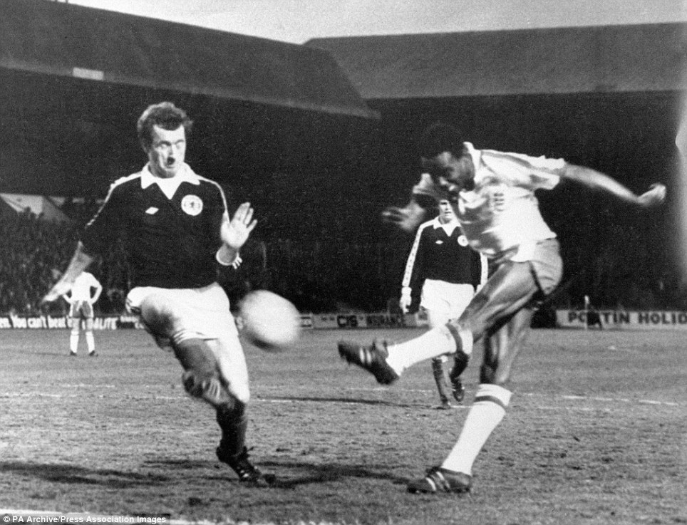 England debutant Laurie Cunningham sweeps the ball past Scotland's Bobby Reid during the Under-21 match at Bramall Lane.