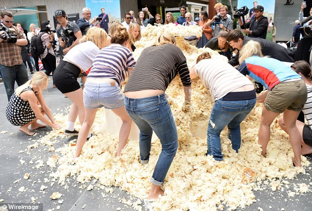 A piece of cake: There was a ring hidden in a giant wedding cake which a group of women dove into