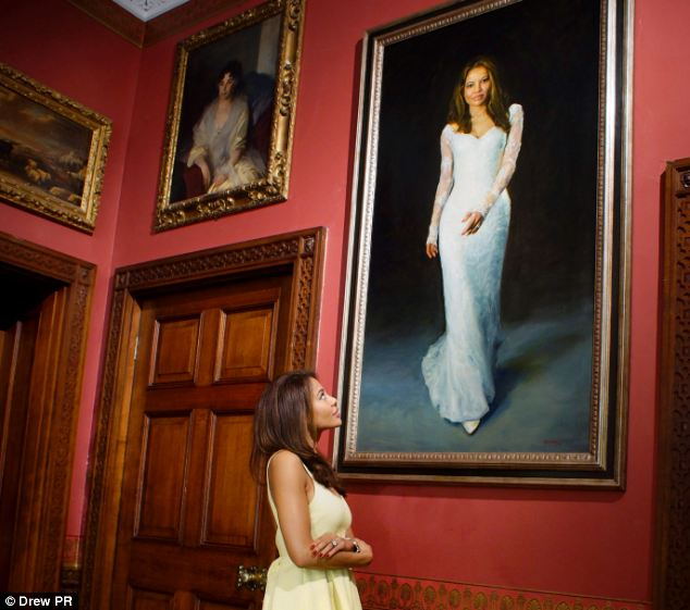 Portrait: Lady Emma poses alongside her bridal portrait, which was painted by renowned artist Paul Benney