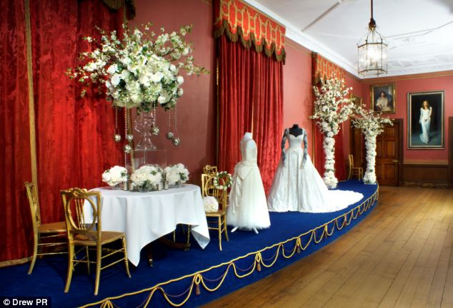 Act of defiance: Emma McQuiston, 27, has decorated Longleat House with her designer wedding dress (centre) and a large portrait of herself (far right) after she married Lord Bath's son, Ceawlin Thynn, in June last year