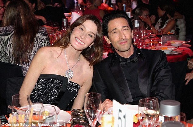 Take a seat: Carla Bruni-Sarkozy and Adrian Brody were sat together at the event