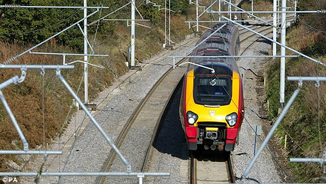 On the wrong track? The timing of the announcement - amid the glare of publicity on local election results - prompted unions to accuse Network Rail of  trying to 'bury bad news'